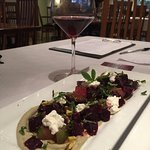 Beets and apple salad over pureed sunchokes with goat cheese topping