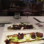 Bacon wrapped dates with a sweet wine reduction sauce