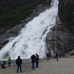 The people really show this waterfall's impressive magnitude