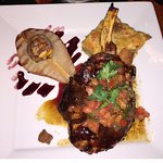 Pork chop with baked pear and cornbread pudding