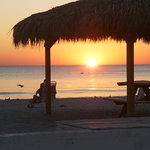 Enjoy the sunset from our private beach