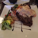 Surf and turf, T-bone steak 18oz. With shrimps on top
