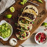 Black Bean and Pomegranate Tacos with guacamole, lime and chillies