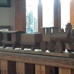 Wooden Train on the railing separating the bar from the dining area