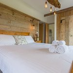 A more typical rustic  style of barn bedroom