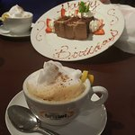 This was my complimentary birthday dessert... Raspberry Chocolate Mousse Cake and a cappuccino..