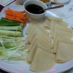 Peking duck condiments: Carrots, Cucumbers, scallions, Wonton wrappers and hoisin sauce
