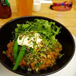 Brown rice bowl with coconut wallaby, fermented daikon, greens and yoghurt