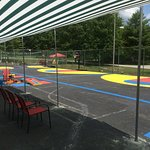 Basketball courts for all sizes, bean bag toss games, shaded sitting area for the family.