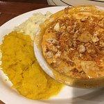 Lobster meat pie with mashed potatoes and pureed squash.