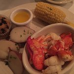 Lobster (after he shelled it out), herbed potatoes, corona the cob, blueberry muffin