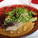 Atlantic cod fish filet with chickpeas and mix leaves