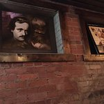 E.A. Poe artwork along the wall.