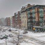 Elysian Cafe whole building shot on corner by Roger J Muller, Jr. during snow storm.