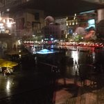 View put of 1st floor window of Hard Rock cafe on to a wet, rainy Krakow square