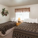 Comfortable beds and rooms at Morrison's Rogue River Lodge.