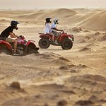 Race across desert dunes on an adventure holiday in Dubai this winter