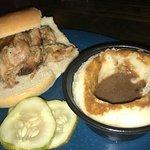 Pork BBQ sandwich w/ side of Mashed Potatoes & Gravy