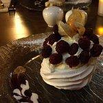 Dessert, fresh cream and raspberries