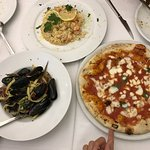 Risotto with lemon shrimp, homemade pasta with seafood and cherry tomatoes, and margherita pizza