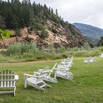 Chairs adorn the lawn along the Rogue River at Morrison's Lodge.
