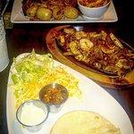 Back: Combo platter (BBQ beef, pulled pork, smokey fries, garlic potatoes) Front: Chicken fajita