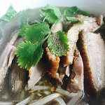 Strongly recommend roast duck noodle soup. Personally like the pad sew eew too.  The green curry