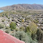 View over the village and fields at the foot of the Gompa