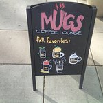 Mugs Sign outside the storefront