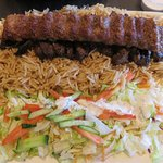 Generous portion of Sultani Kababs - Veal morsels, Minced Beef, rice and salad with yogurt dress
