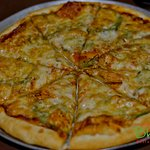You can't buy happiness but you can buy pizza at Bhumi and that's kind of the same thing.