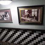 tiles and old photos on the stairs to the toilets