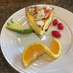 Quiche with fresh lobster following organic yogurt and fresh berries, homemade granola.