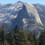 Half Dome, seen from Sentinel Dome.Sierra peaks beyond.