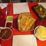 Lamb vindaloo, saffron rice, garlic naan, chicken tanduri with lemon. All delicious.
