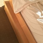 wooden edge at side of bed - hard on your legs when getting in and out