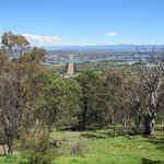 View of Canberra, with Parliament House in the background and Lake Burley Griffin