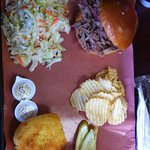 Pulled Pork Sandwich on Brioche Bun with coleslaw and corn bread