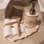 A fern leaf is placed on each of the bathroom towels