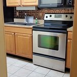 Nicely equipped kitchen with full sized appliances.