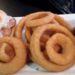 Cuban sandwich w/ onion rings.