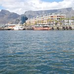 """Distincr view of """"Devil's Peak""""""""to the left of Table Mountain as viewed from Victoria Harnour"""