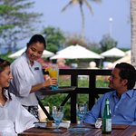 This outdoor restaurant has a splendid view of the poolside and gardens. Tomato is perfect for a