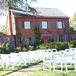 Front of Manor with chairs for ceremony.
