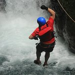 Zipline to a water fall pullback drop in water swim to shore