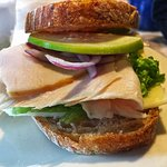 Vermonter sandwish of freah bread, cabot cheddar, lettuce, red onion, granny smith apple and tur