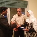 Me and my wife recieving a resent of the hotel from Mr. T. Anantharaj the front office manager
