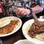 Very large serving of chicken fried steak and gravy which also came with hash browns, eggs, bisc