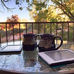 Enjoying morning coffee and Kindle reading with my wife in the peace and quiet.