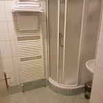 Towel dryer and shower cabin